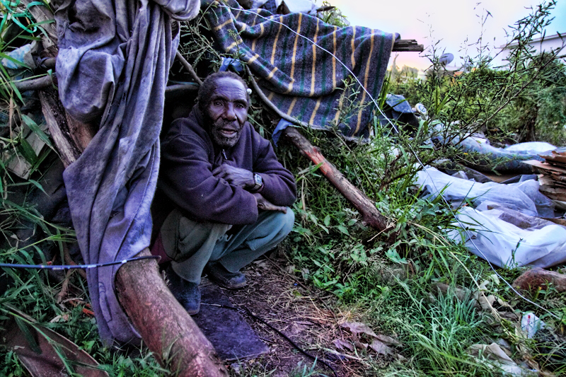 Christmas 2016 in City Cotton Nairobi. A resident sitting outside his hut made from waste materials.